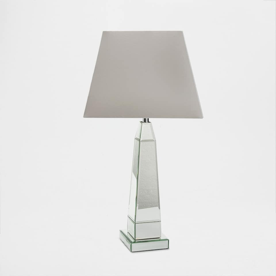 Lamp with a mirror-effect base