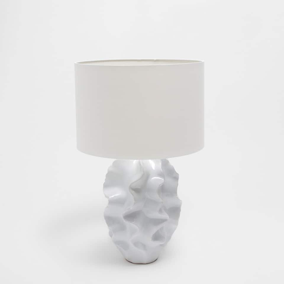 Lamp with a wavy base