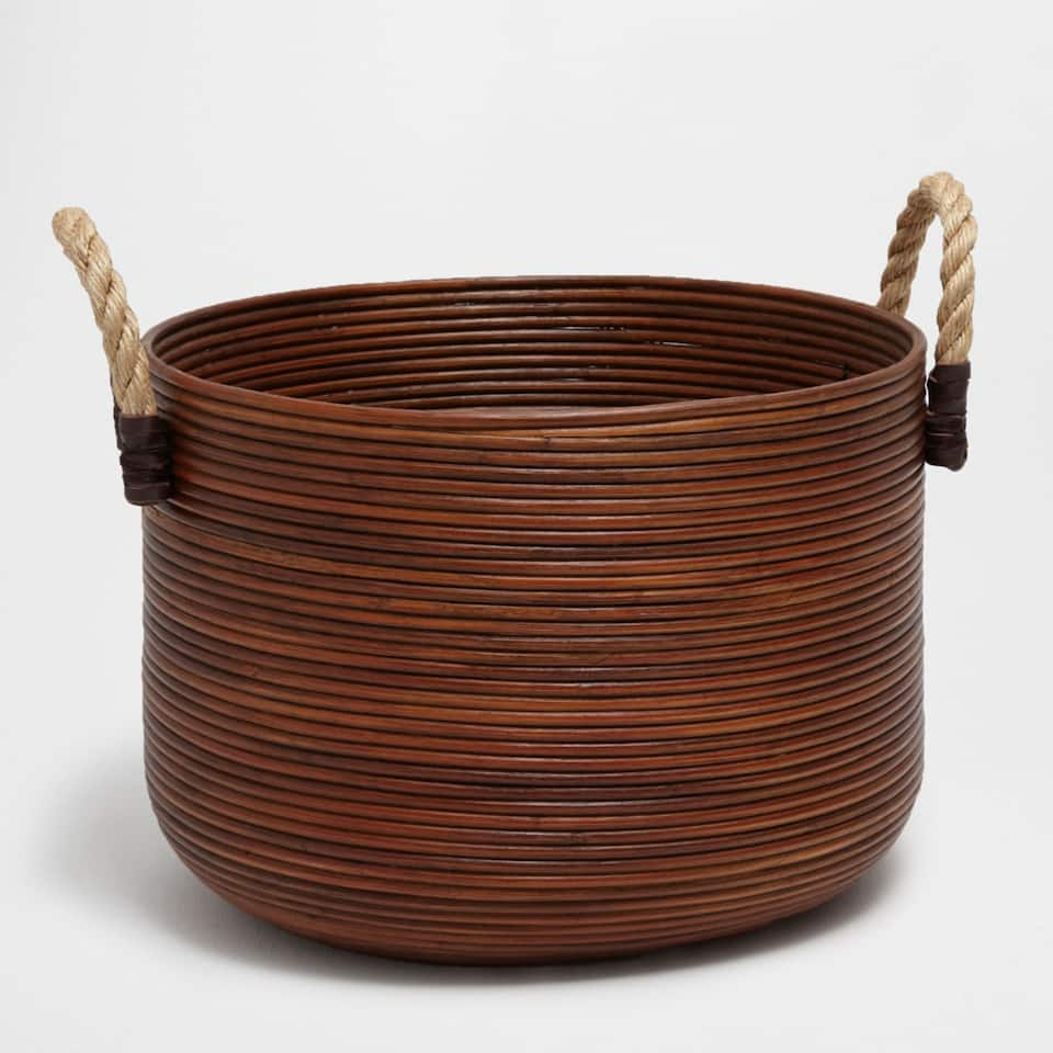 Large rattan basket with handles