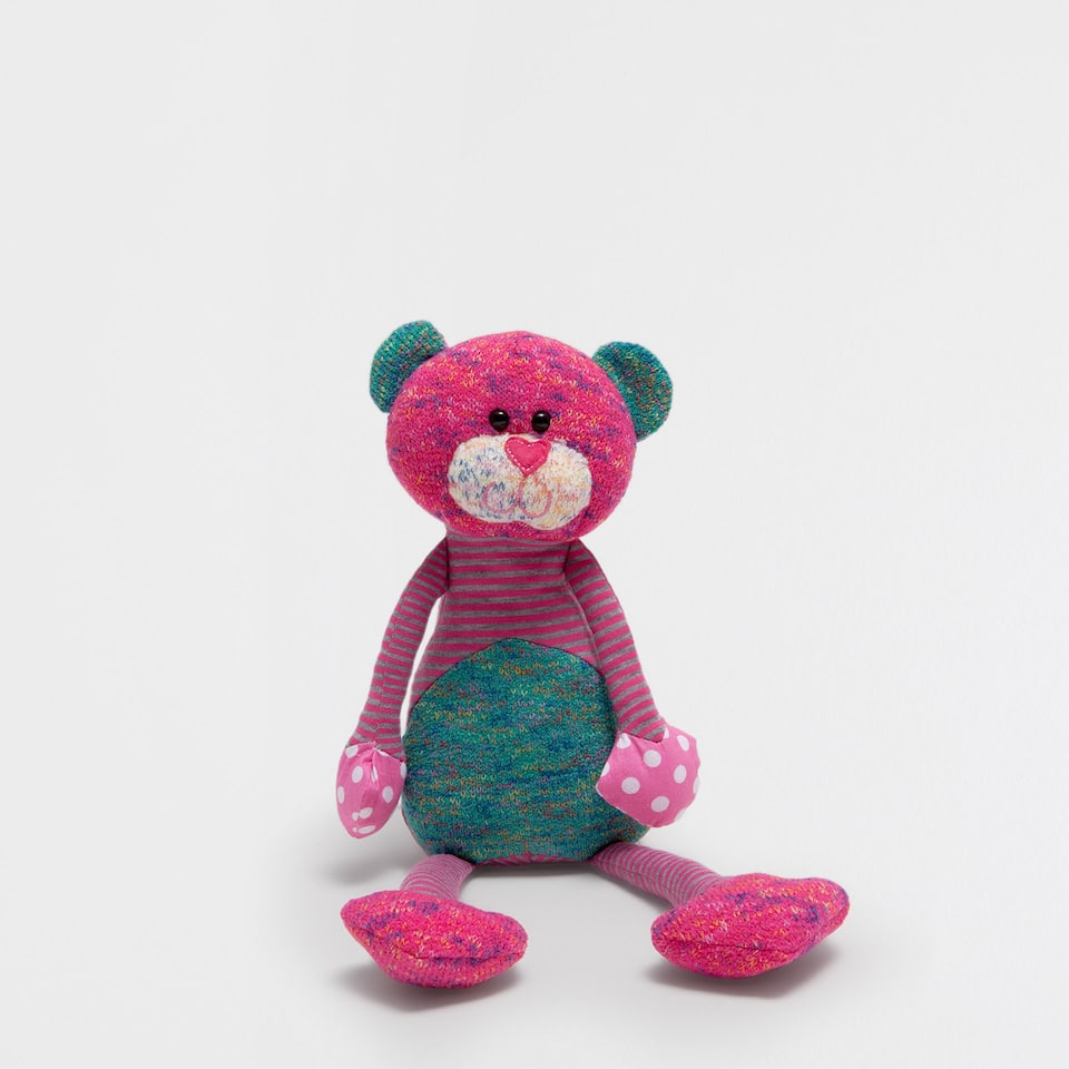 Multicoloured bear soft toy