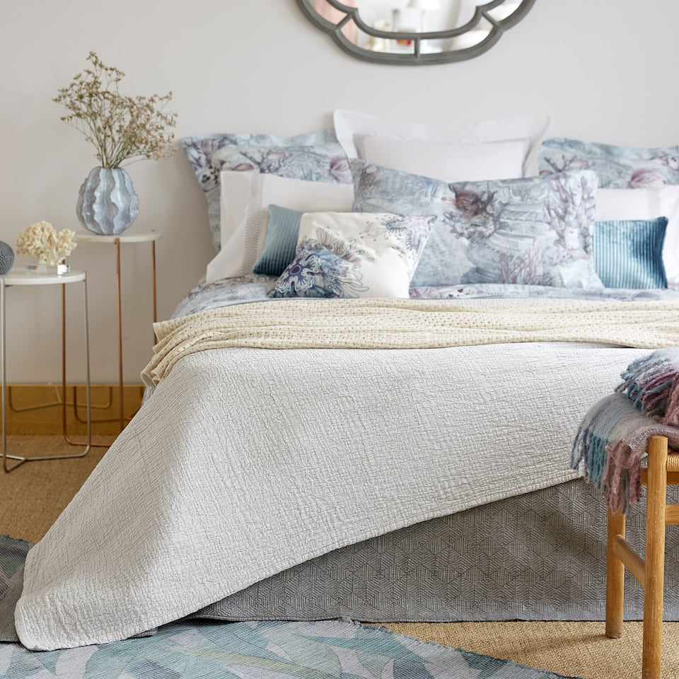 Light grey textured bedspread
