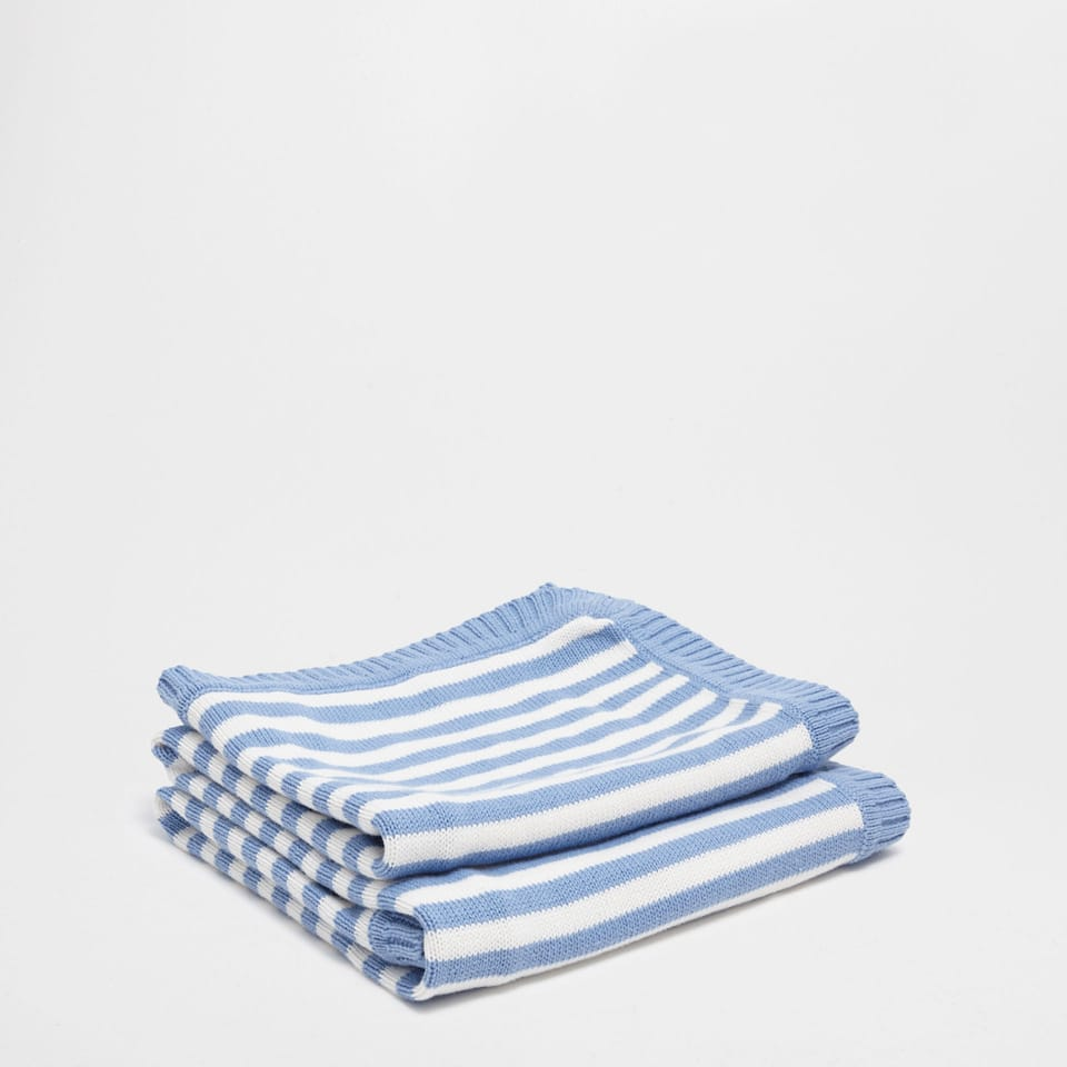 WHITE AND BLUE STRIPED BLANKET