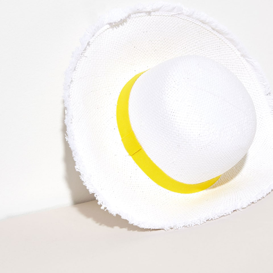 White straw hat with yellow ribbon