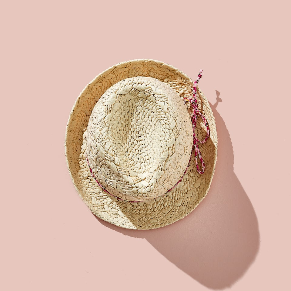 HAT WITH PINK CORD