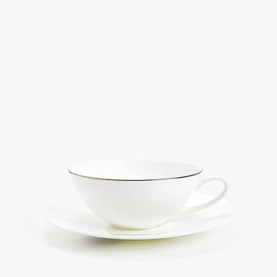 SILVER-RIMMED BONE CHINA TEACUP AND SAUCER