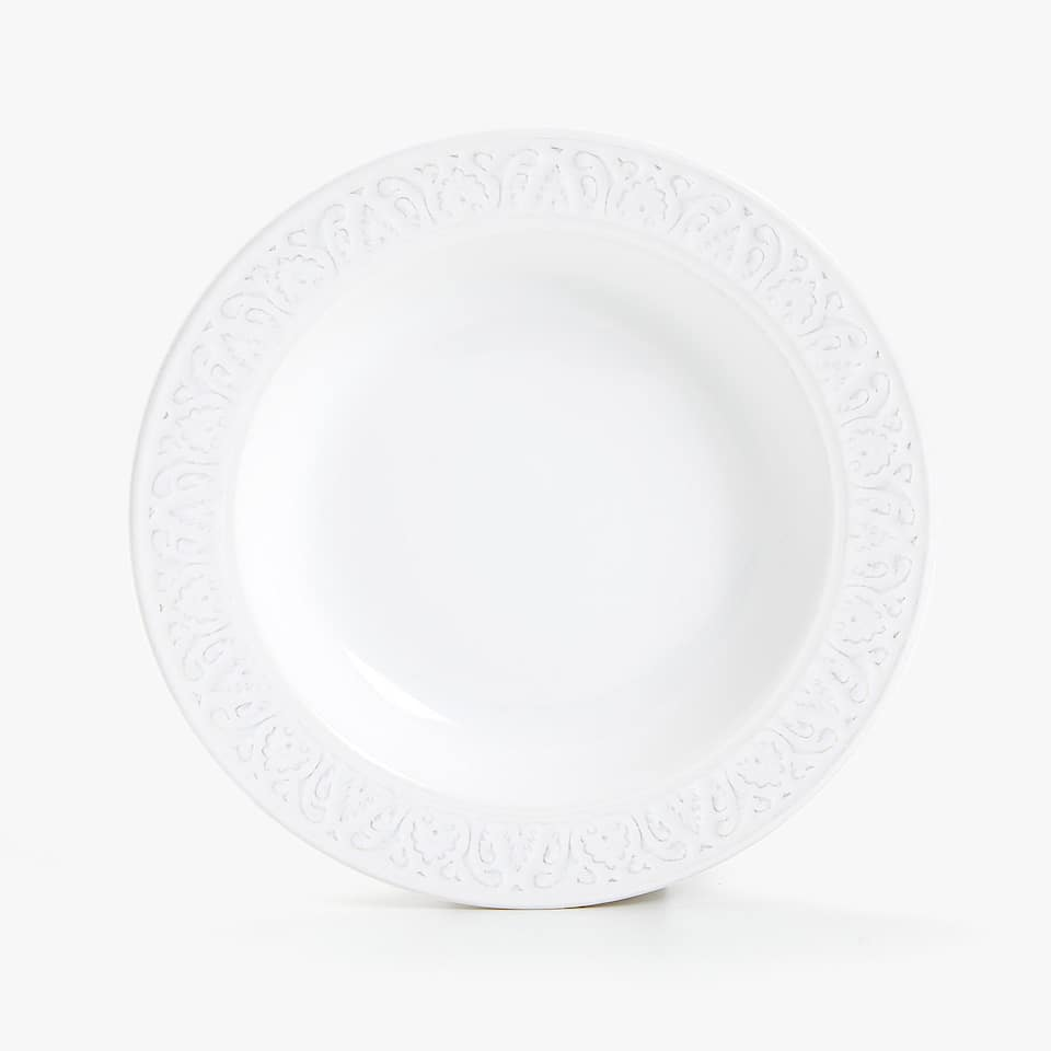 WHITE RAISED-DESIGN EARTHENWARE SOUP PLATE