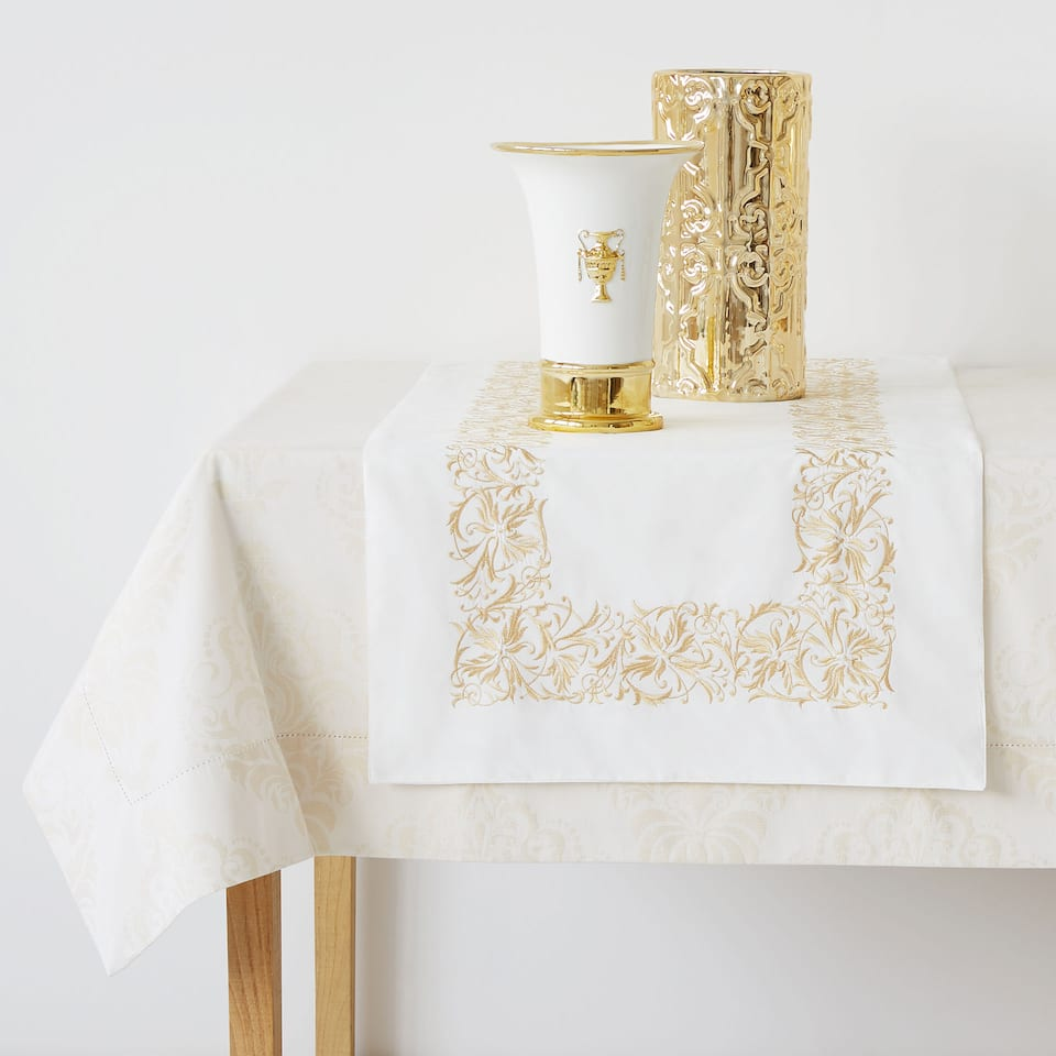 White table runner with gold embroidery