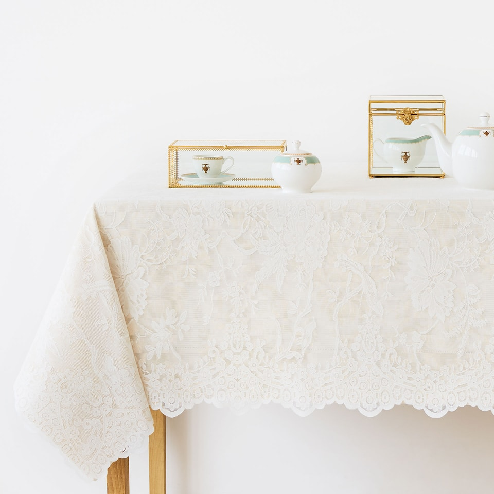 Ecru lace-trimmed tablecloth
