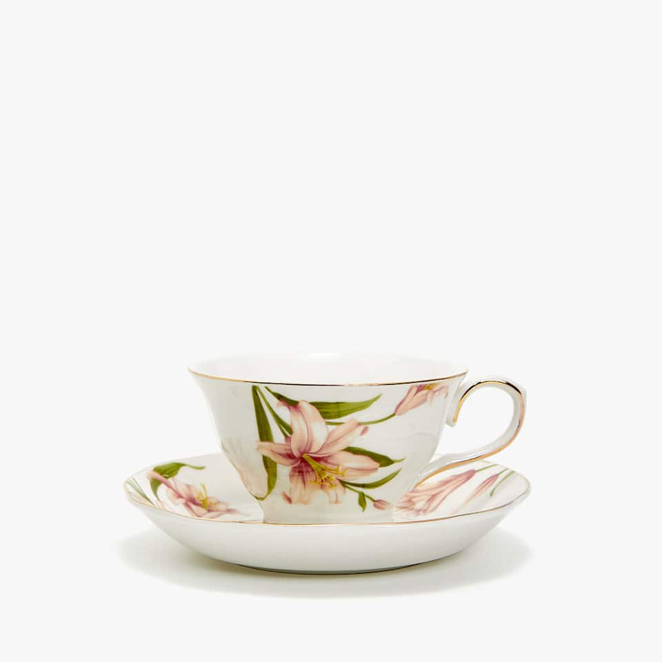 GOLD-RIMMED TEACUP AND SAUCER WITH FLORAL TRANSFER
