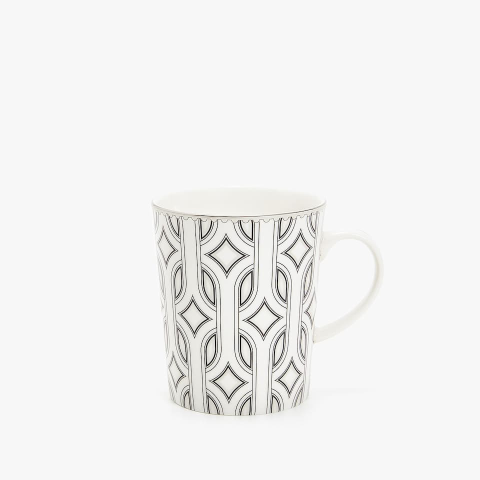 PORCELAIN MUG WITH RAISED OPTICAL-EFFECT DESIGN