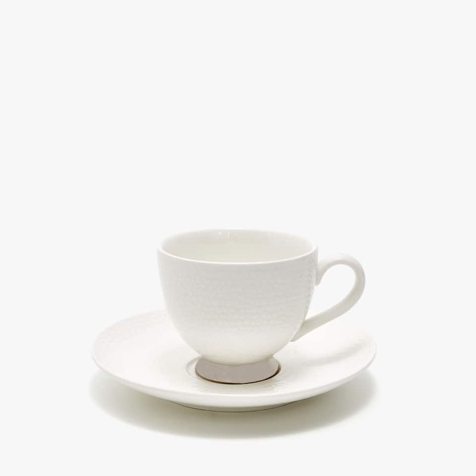 TEXTURED PORCELAIN TEACUP AND SAUCER