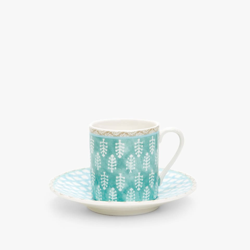 PORCELAIN COFFEE CUP AND SAUCER WITH CONTRASTING TRANSFERS