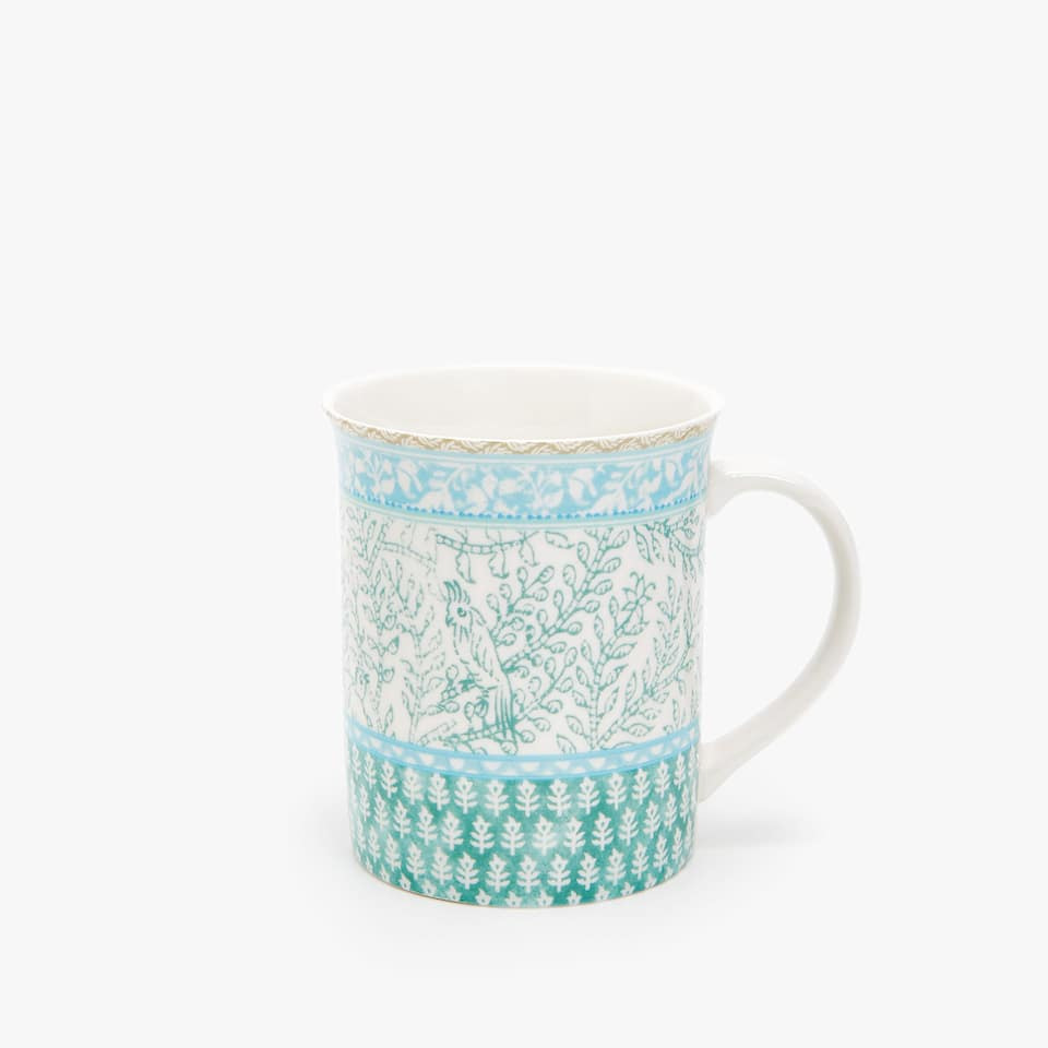 PORCELAIN MUG WITH CONTRASTING TRANSFERS