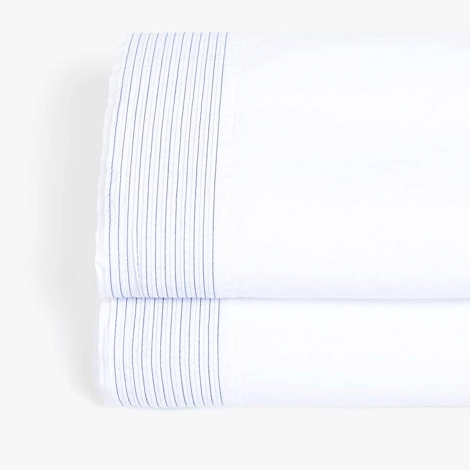 TOP SHEET WITH CONTRASTING PLEATED BORDER