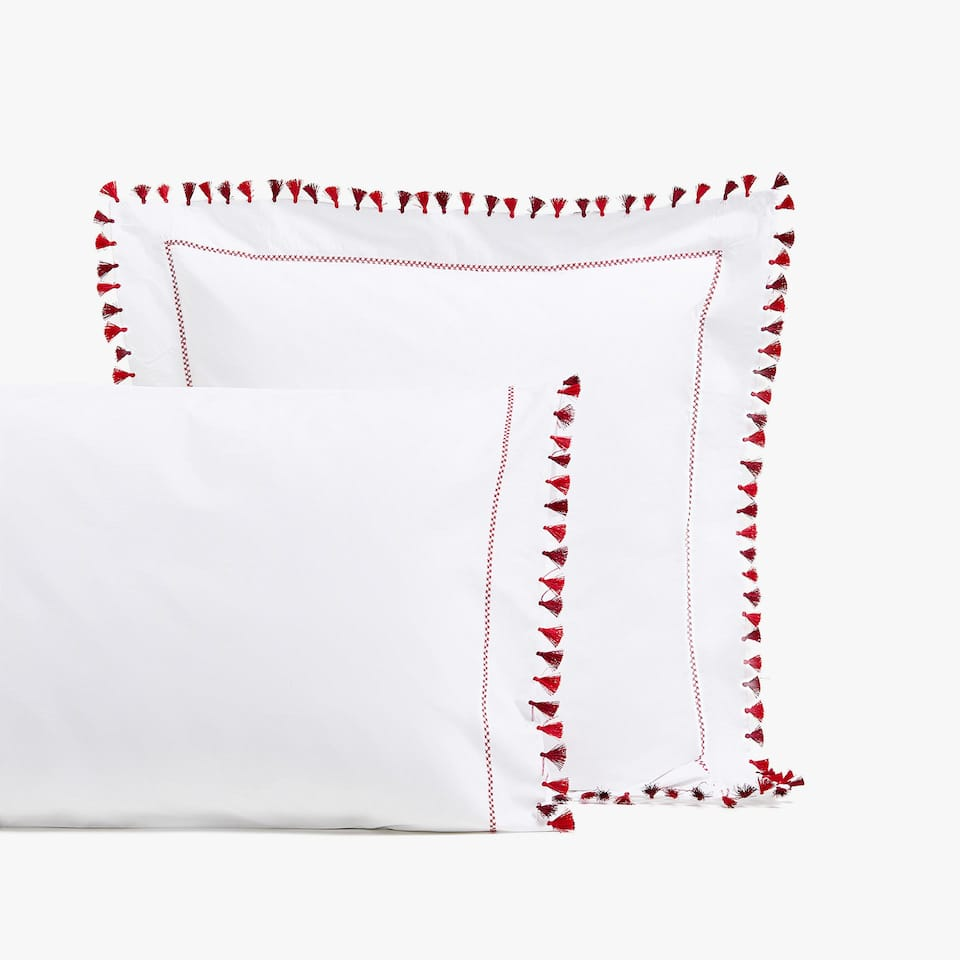 PILLOWCASE WITH RED TASSELS