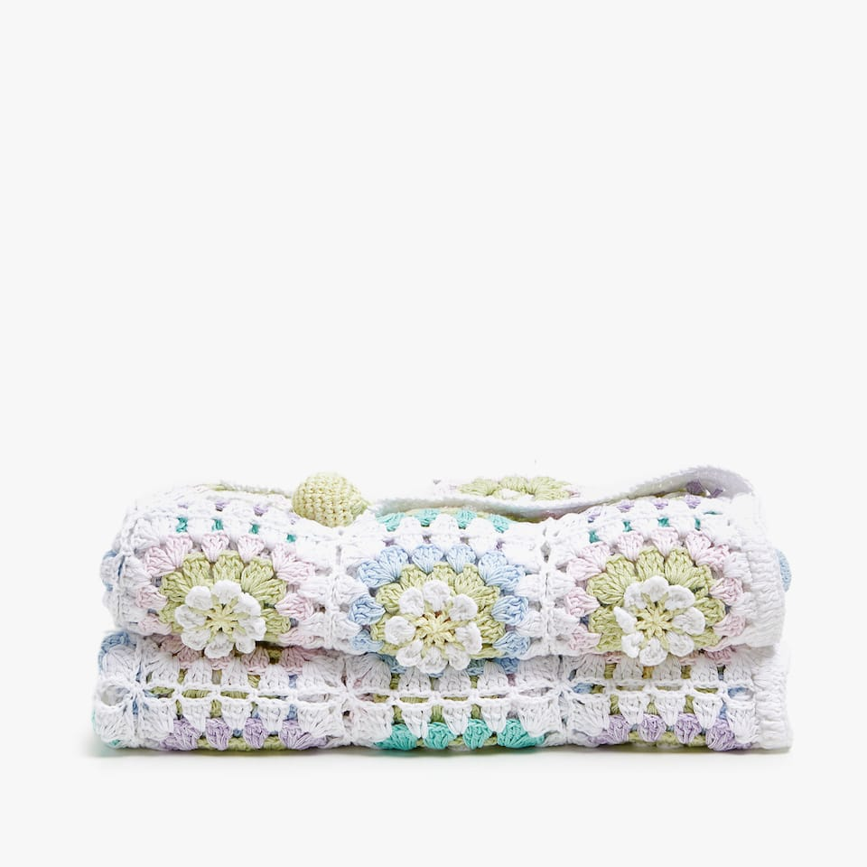 FLORAL CROCHET BLANKET WITH POMPOMS