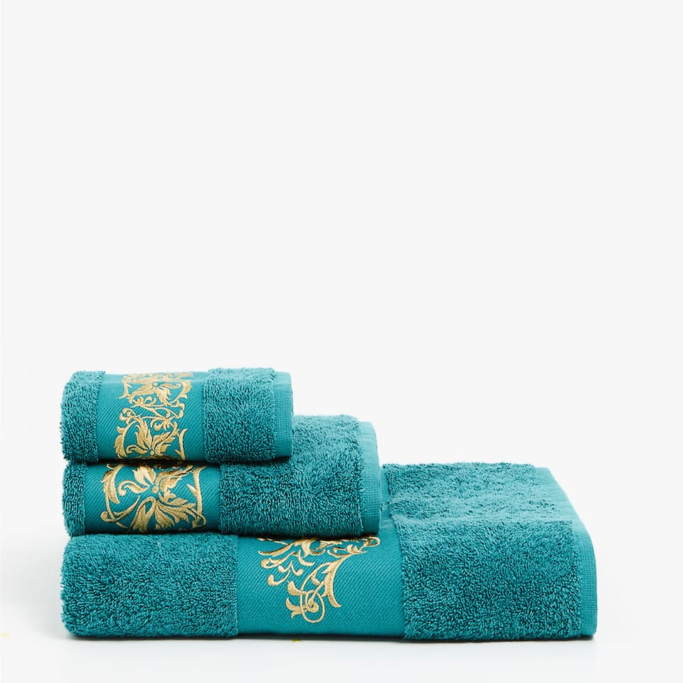 Emerald towel with embroidered border