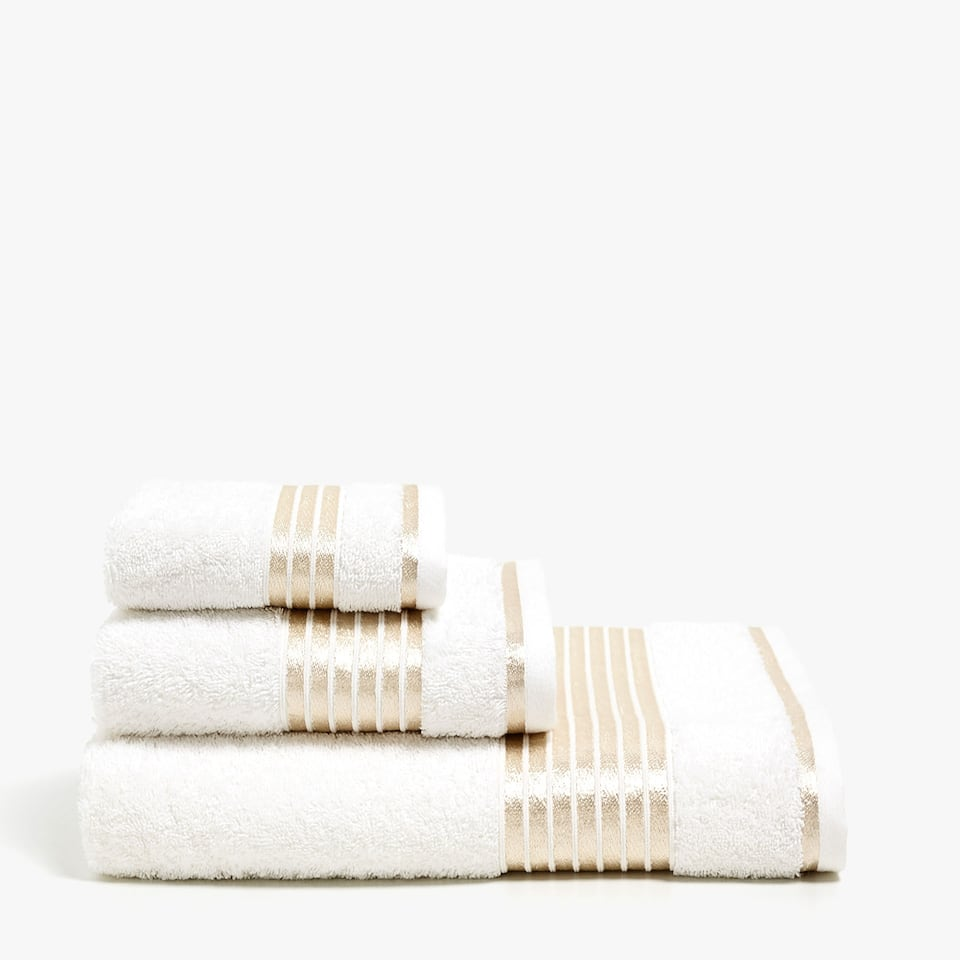 Towel with gold stripes