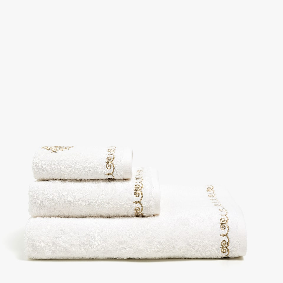 Towel with gold damask embroidery