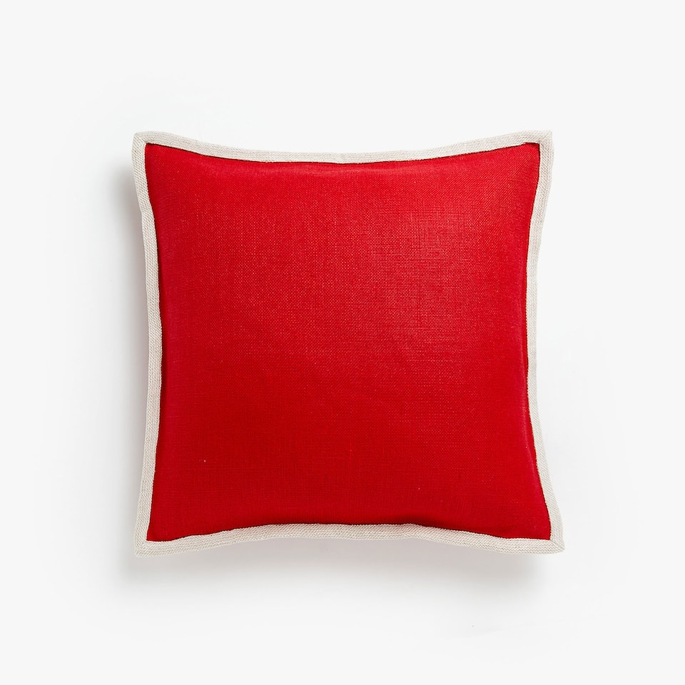 Cushion cover with contrasting piping