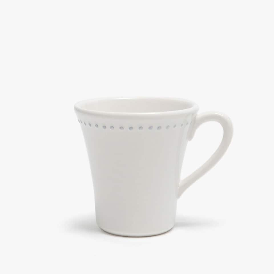 Earthenware mug featuring raised details