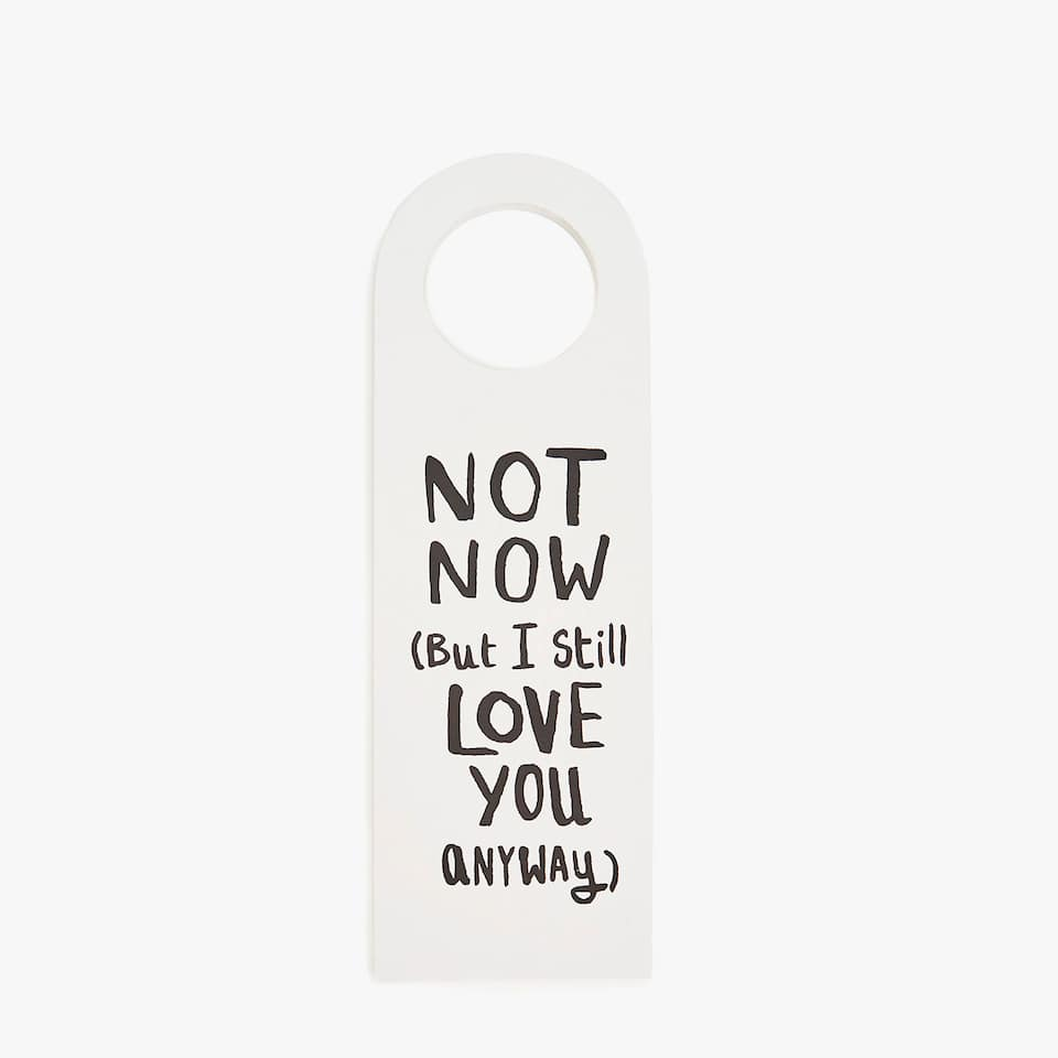 Door hanger with slogan
