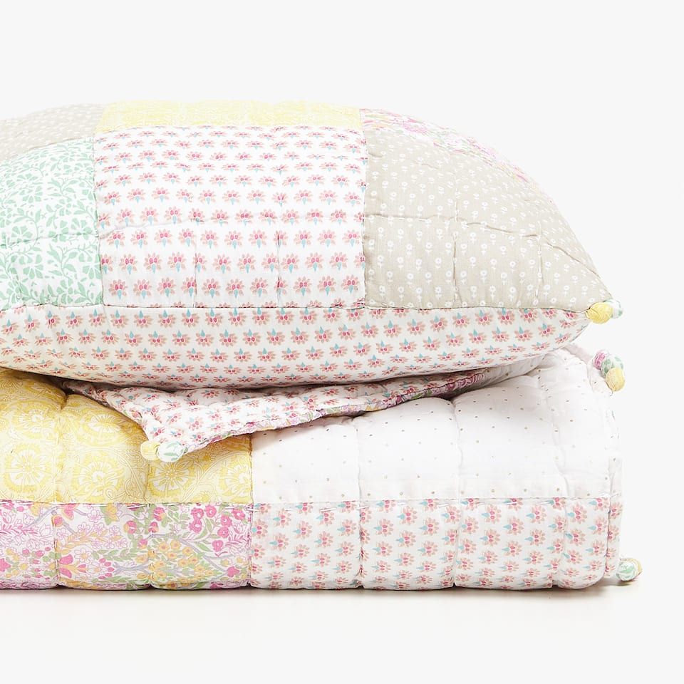 MULTICOLOURED PATCHWORK QUILT WITH POMPOMS