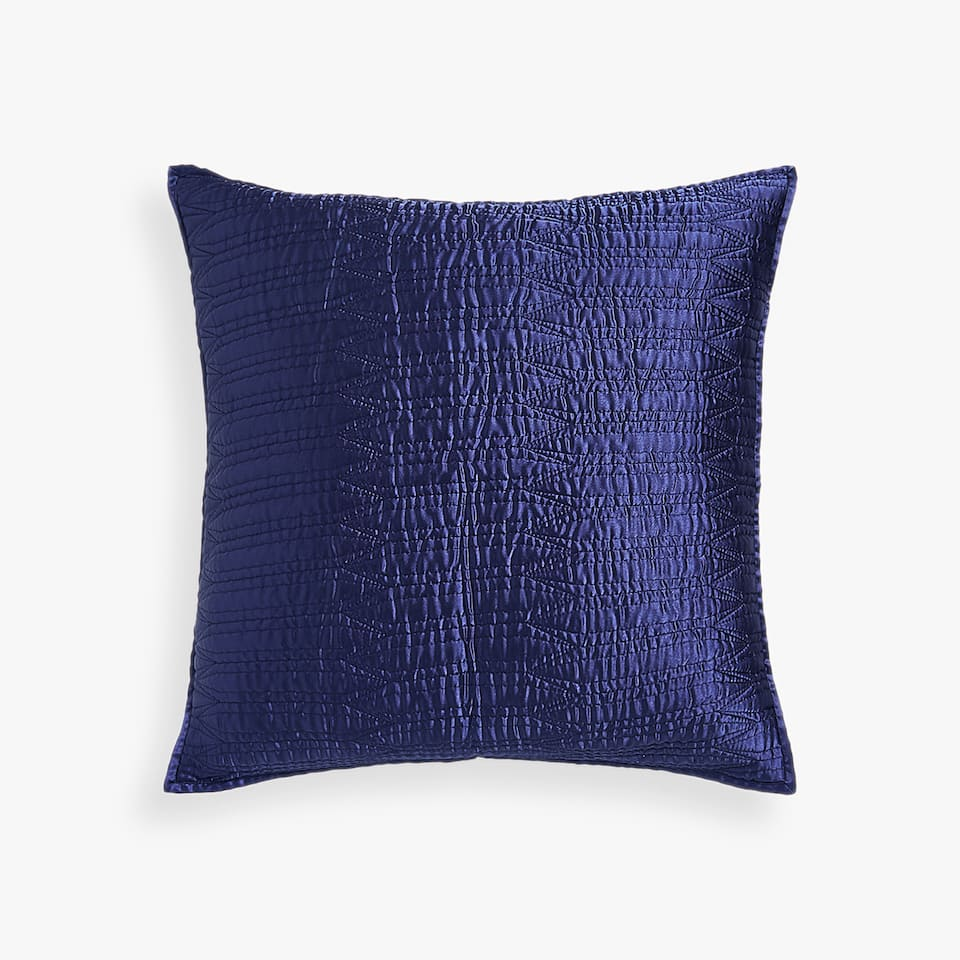 BLUE CUSHION COVER WITH A STITCHED ARROWS DESIGN
