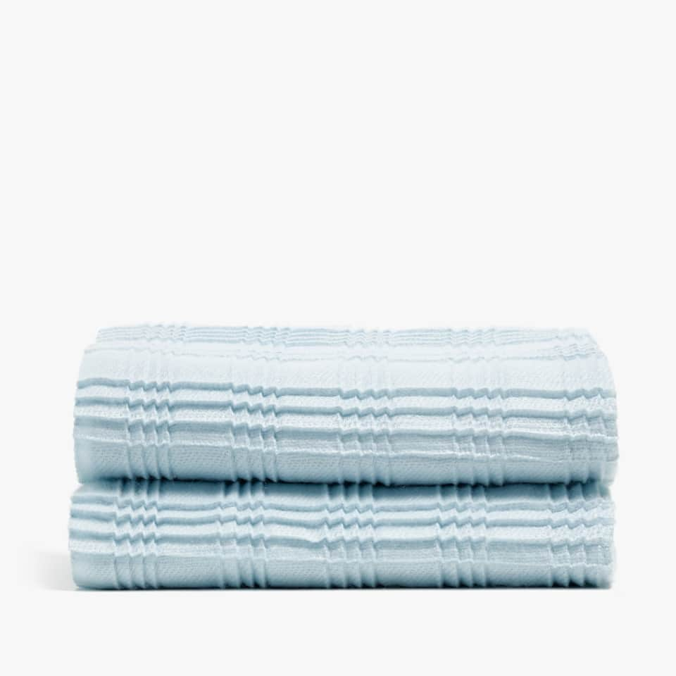 FRINGED BLANKET WITH PLEATS
