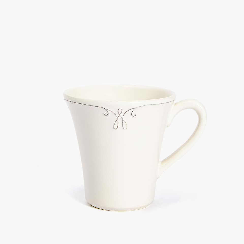 EARTHENWARE MUG WITH RAISED-DESIGN RIM