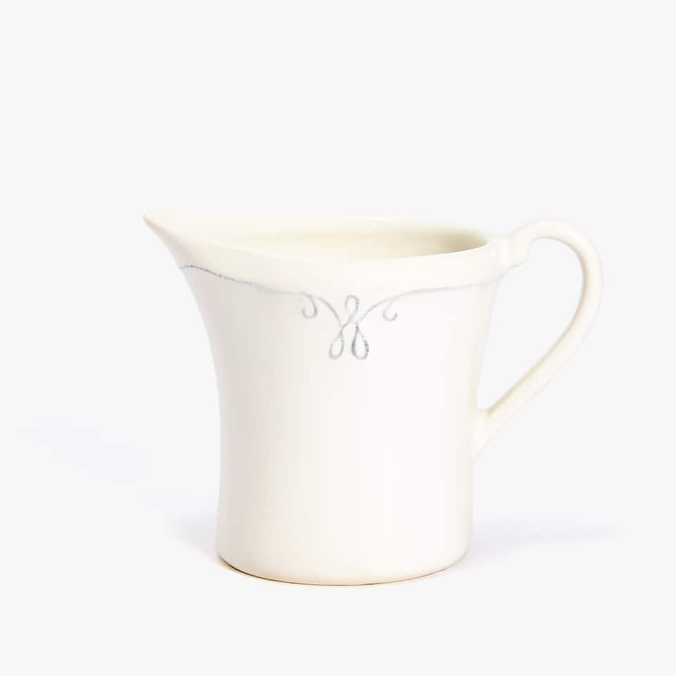 EARTHENWARE MILK JUG WITH RAISED-DESIGN RIM