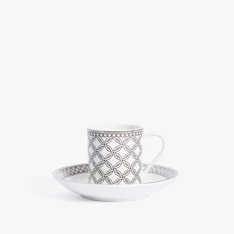 PORCELAIN COFFEE CUP AND SAUCER WITH SILVER RIM