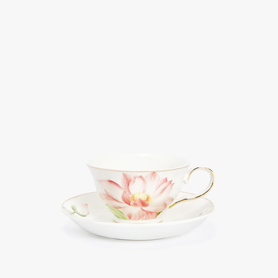 PORCELAIN TEACUP AND SAUCER WITH FLORAL PRINT