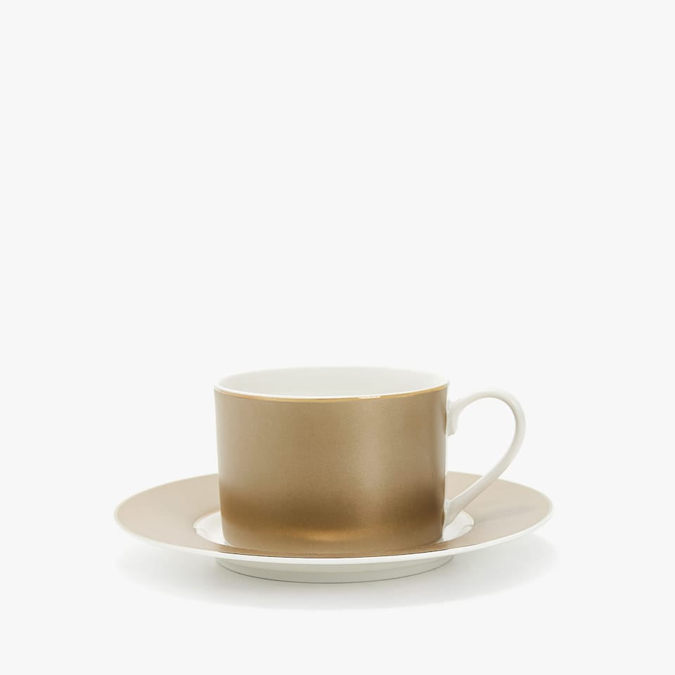 PORCELAIN TEACUP AND SAUCER WITH CONTRASTING STRIPE