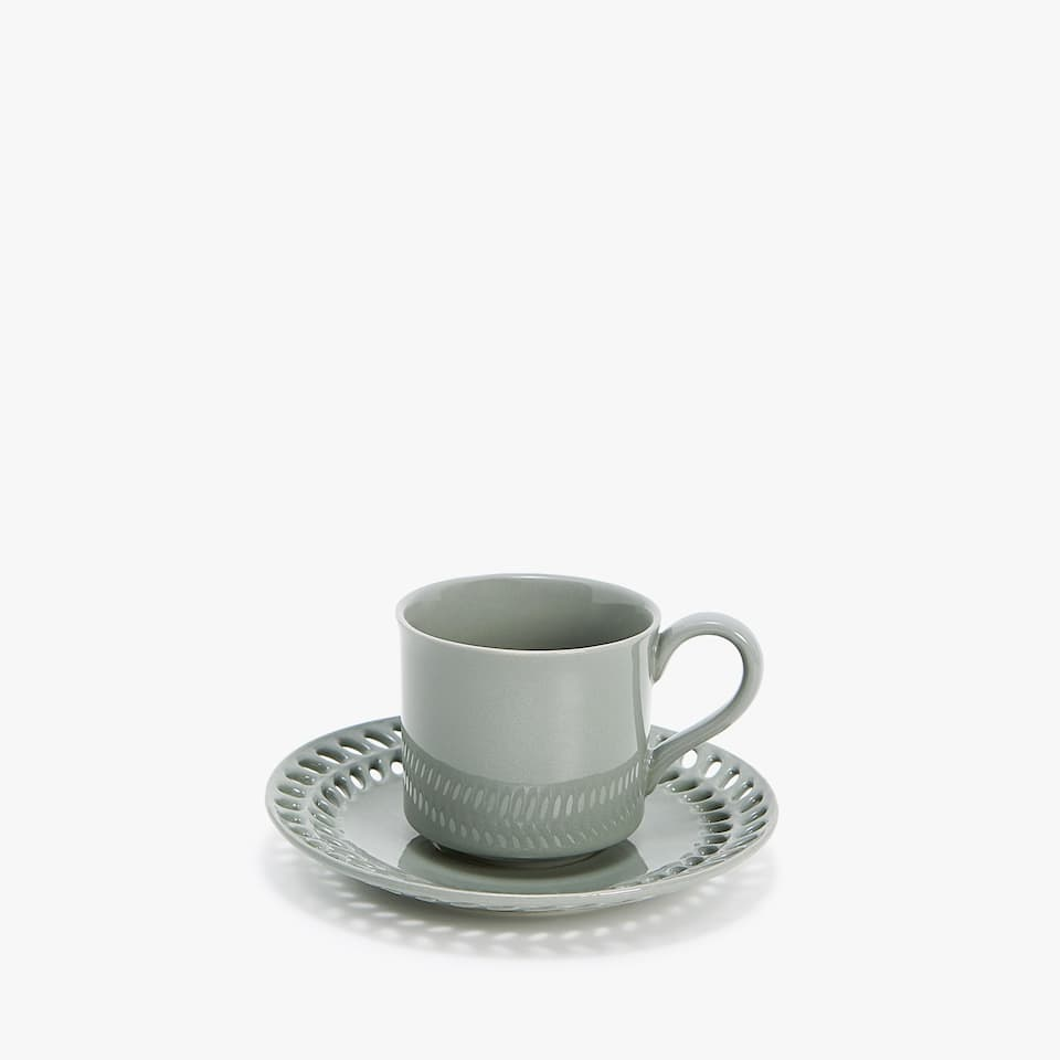 TEACUP AND SAUCER WITH PERFORATED EDGE