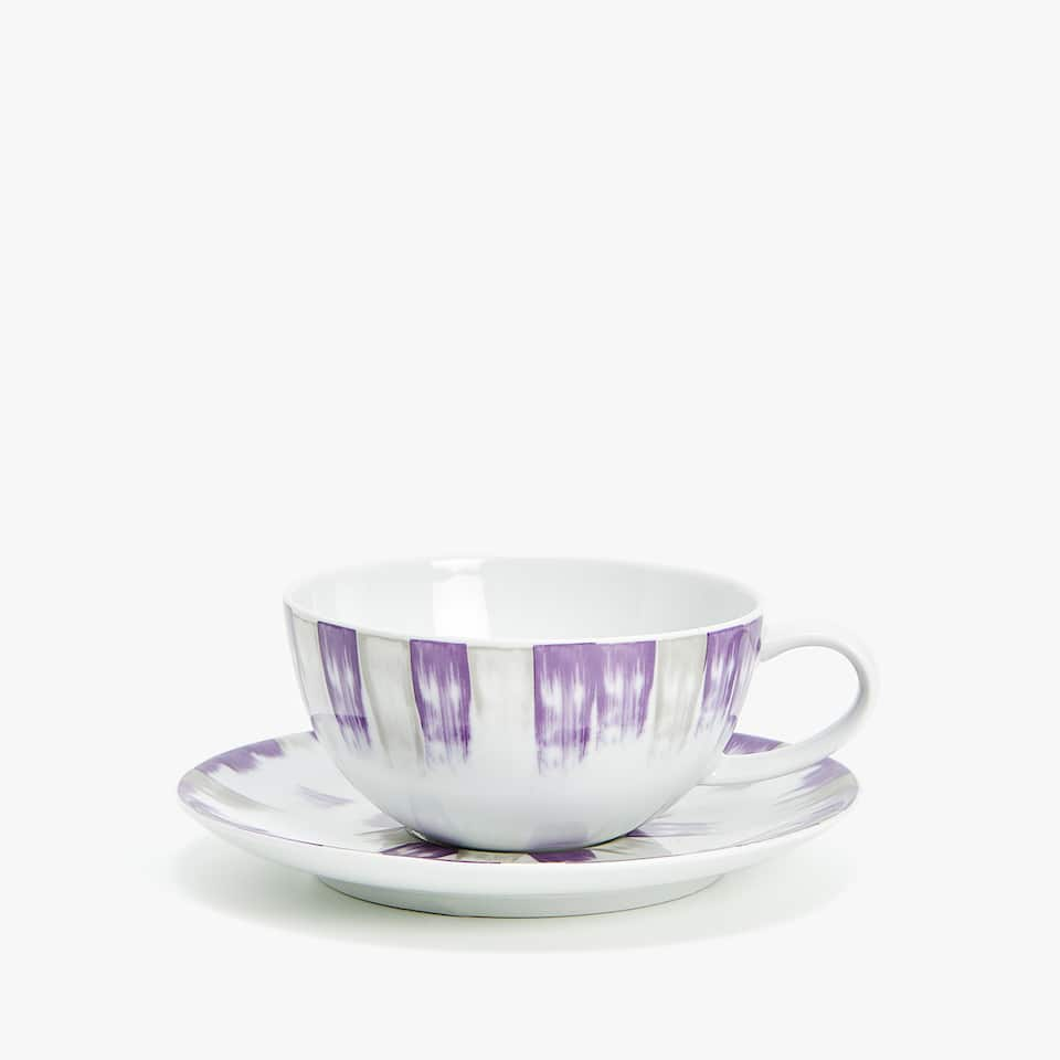 PORCELAIN TEACUP AND SAUCER WITH COLORED BORDER