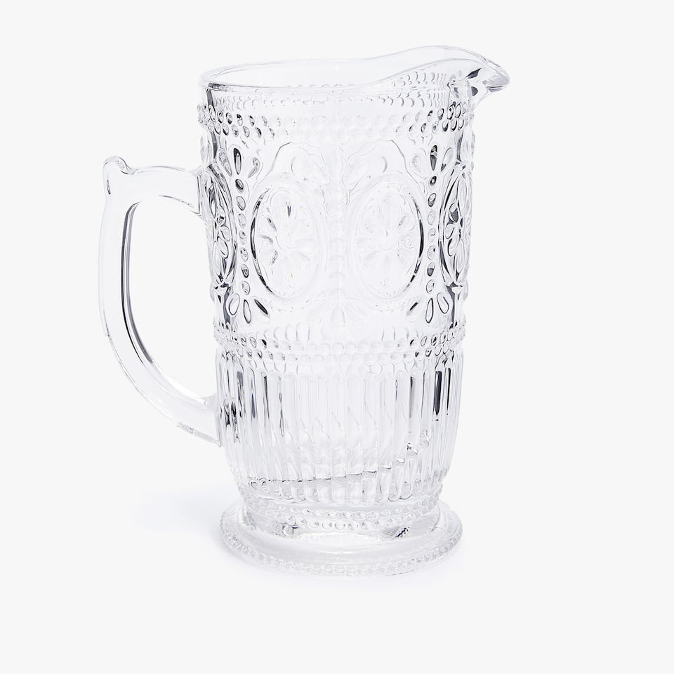 RAISED FLORAL DESIGN GLASS PITCHER
