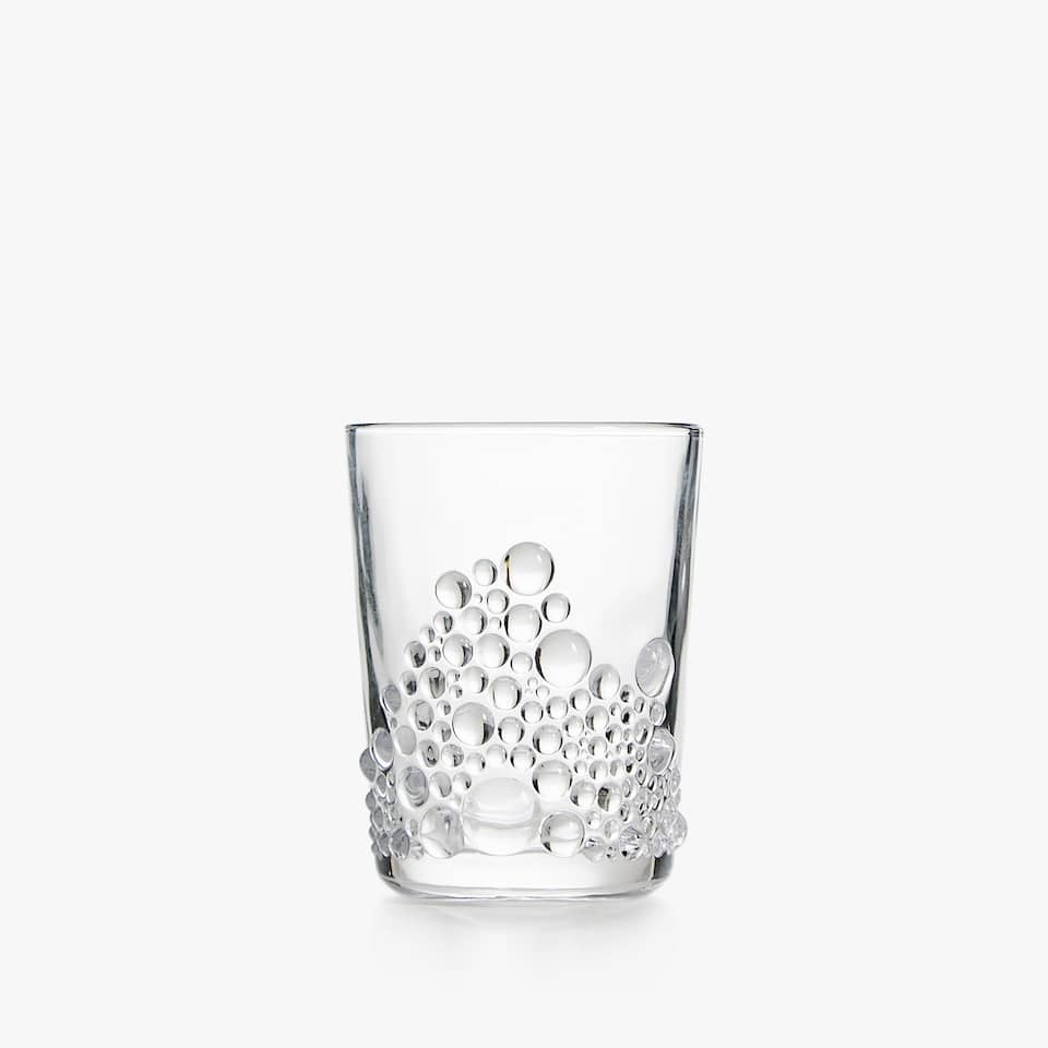 GLASS TUMBLER WITH RAISED DESIGN BASE