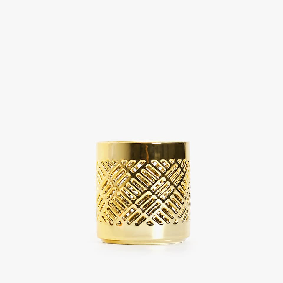 Perforated ceramic tealight holder