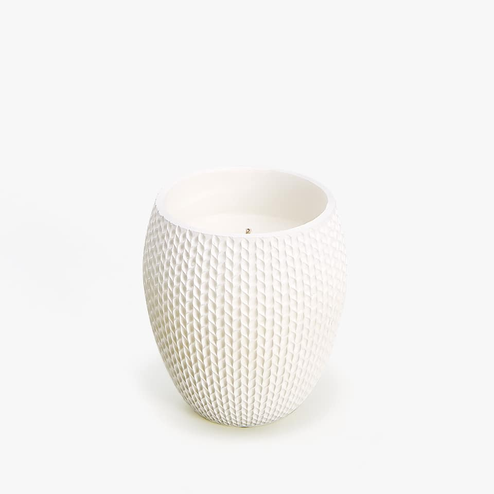 CANDLE HOLDER WITH RAISED HERRINGBONE DESIGN