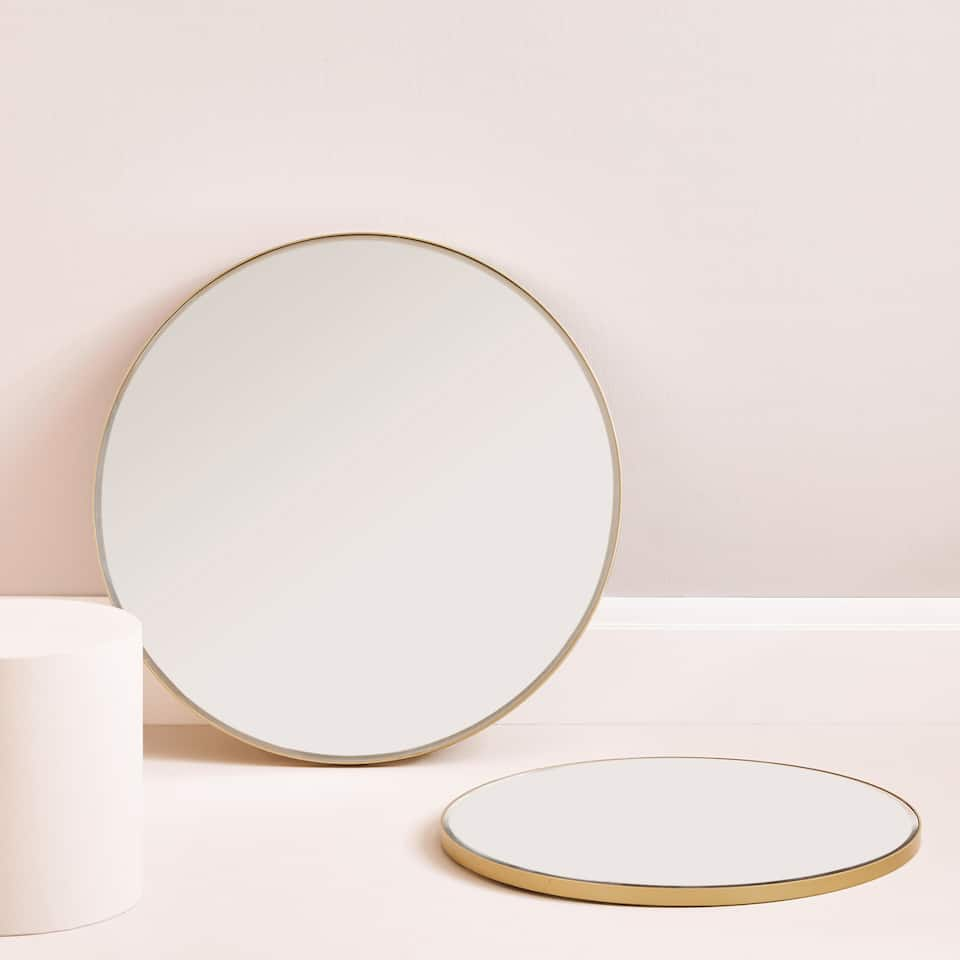 Large round mirror with golden frame