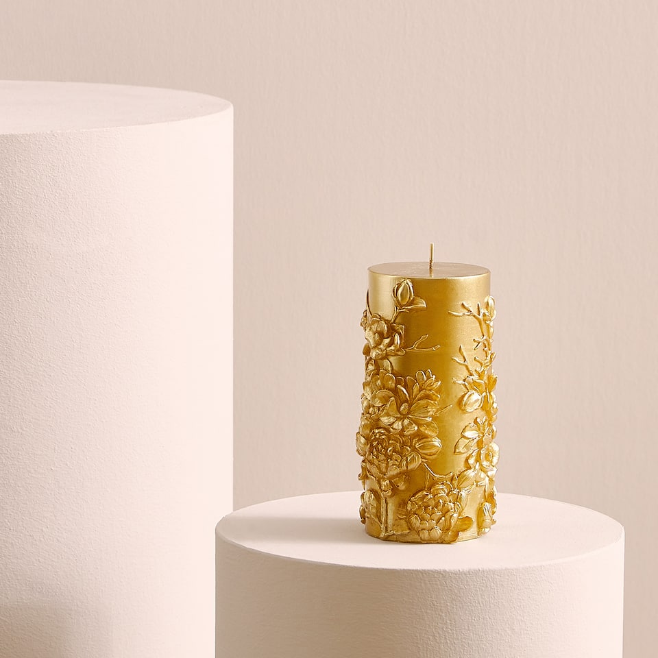 Candle with raised floral design