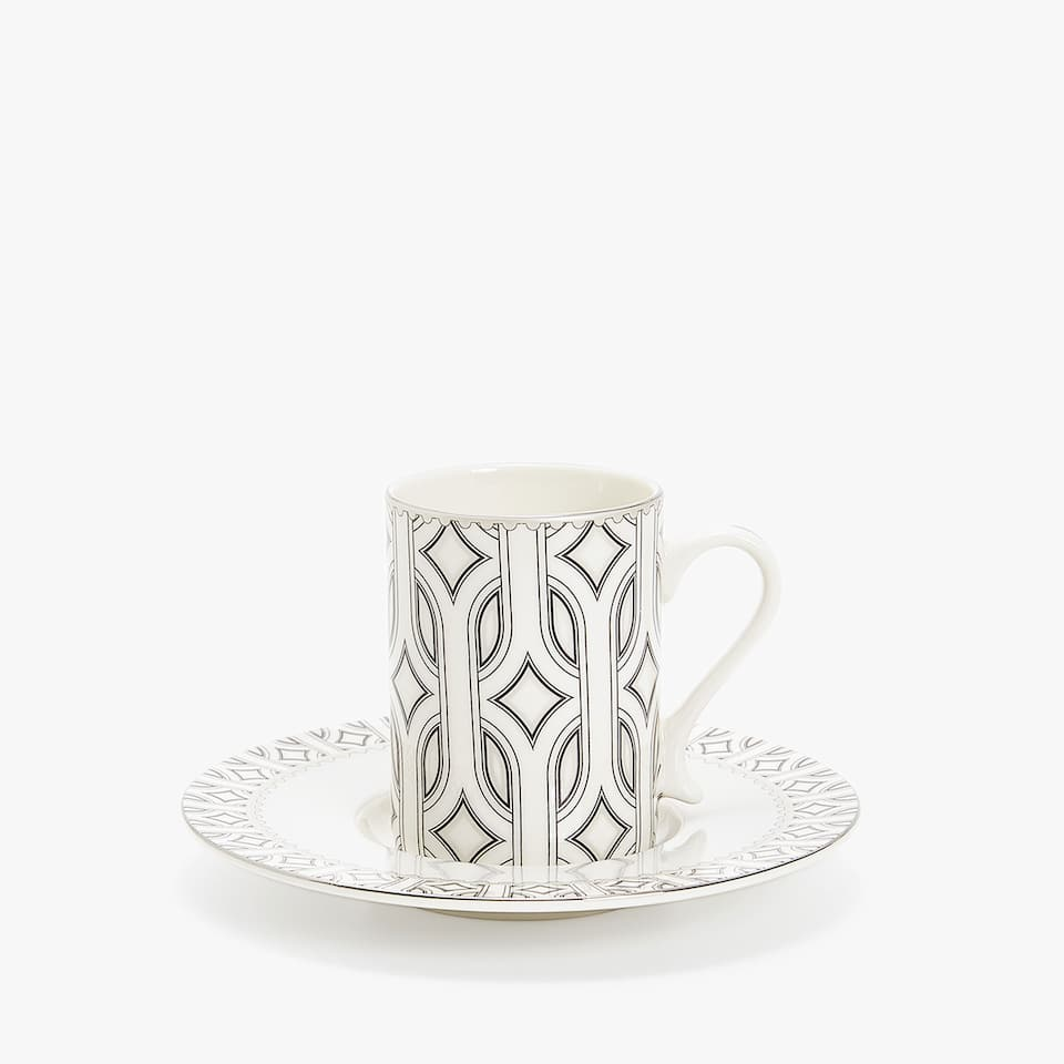 PORCELAIN COFFEE CUP AND SAUCER WITH RAISED OPTICAL-EFFECT DESIGN