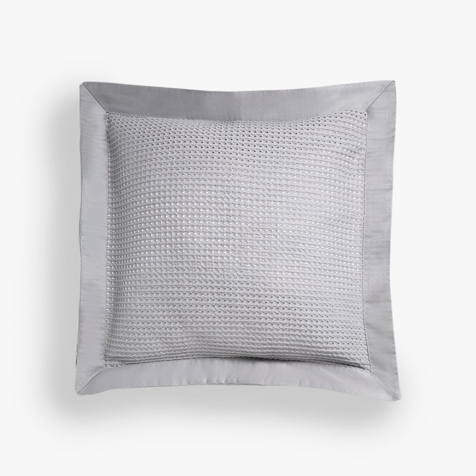 WAFFLE-EFFECT CUSHION COVER WITH APPLIQUÉ TRIM