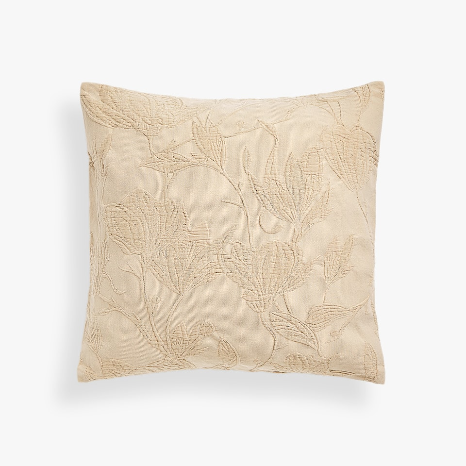 CUSHION COVER WITH TWO-TONE RAISED FLORAL DESIGN