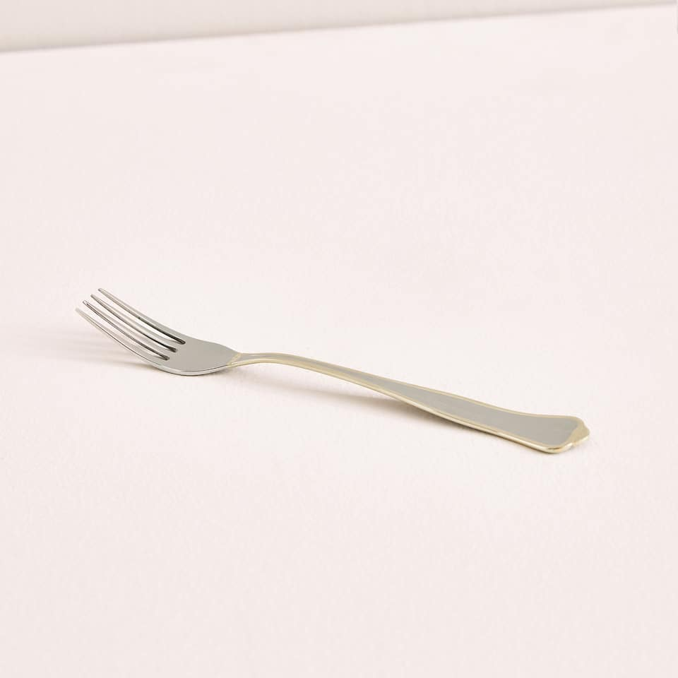 Dessert fork with gold edge