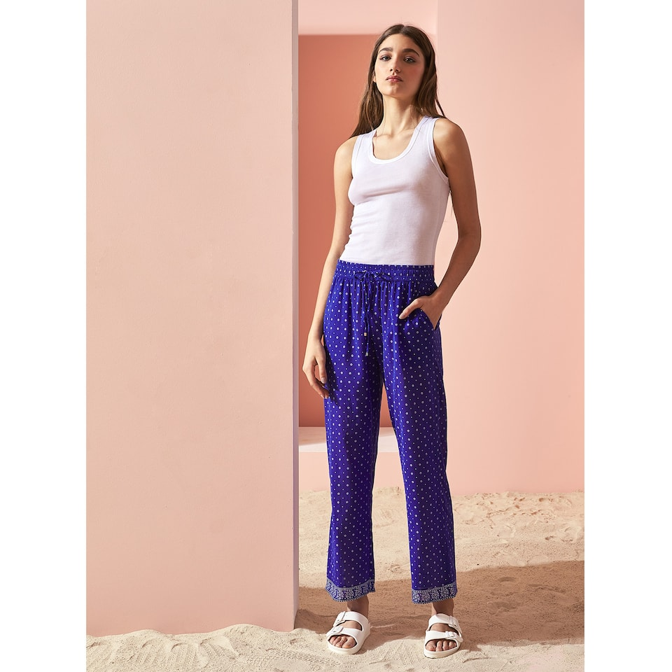 TROUSERS WITH HEM DETAILS