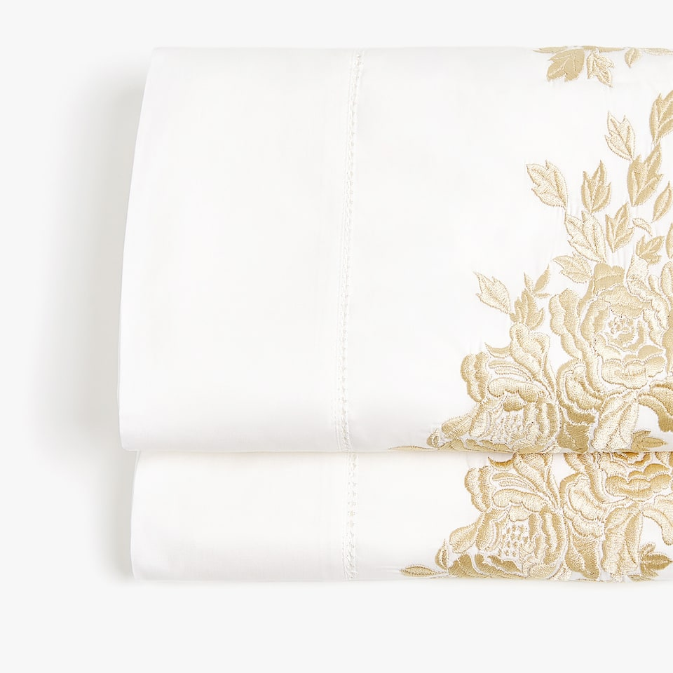 Embroidered top sheet