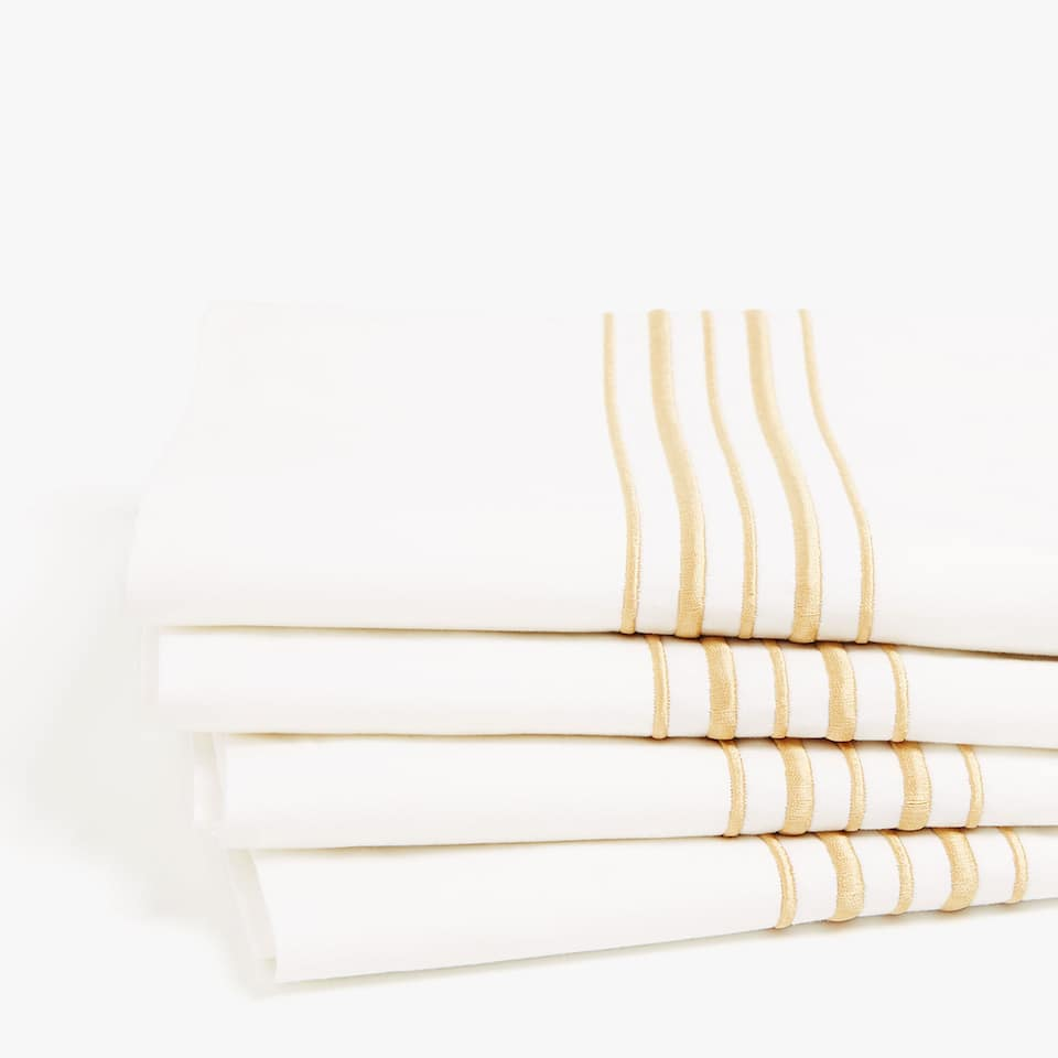 Sheet with gold embroidered trims