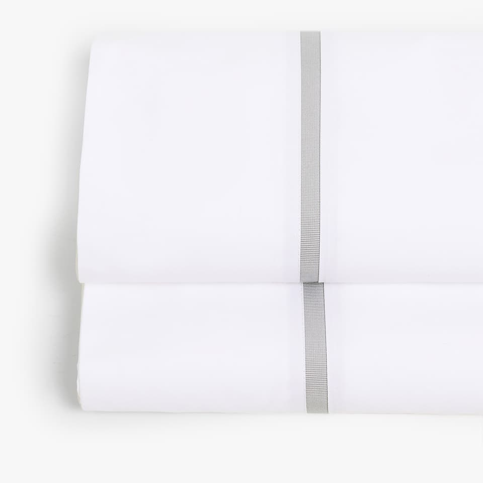 FLAT SHEET WITH CONTRASTING GREY RIBBON